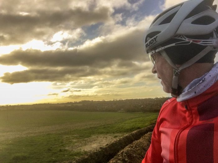 Winter Cycling Cyclinglife One Person Headshot Field Cloud - Sky Sky Clothing Real People Portrait Looking Looking Away Outdoors