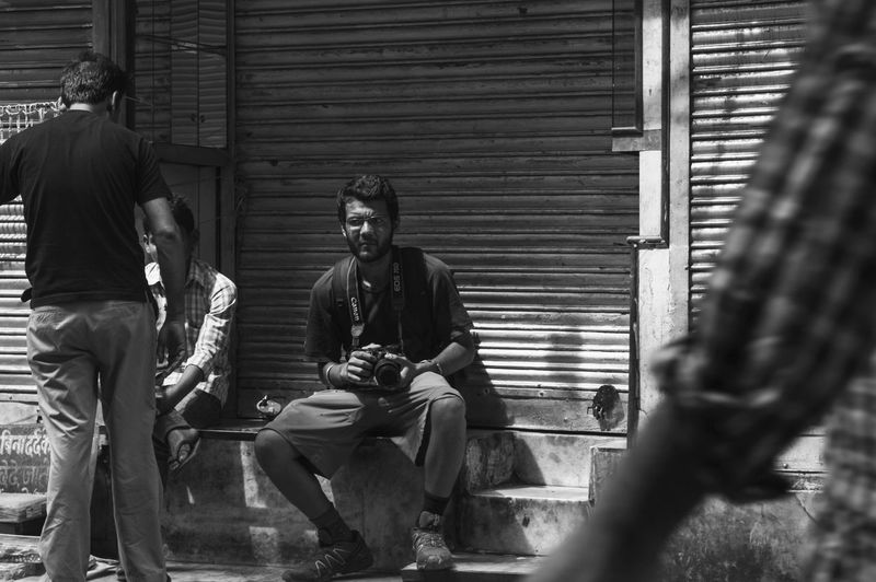 People sitting on wall of building
