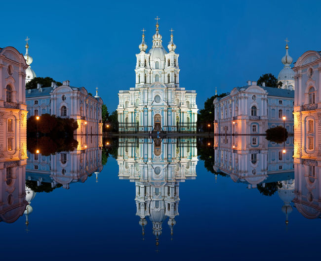 Reflection of historic cathedral on calm water