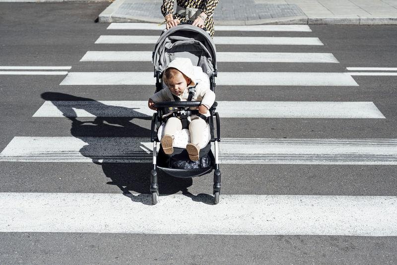 Full length of man sitting on road