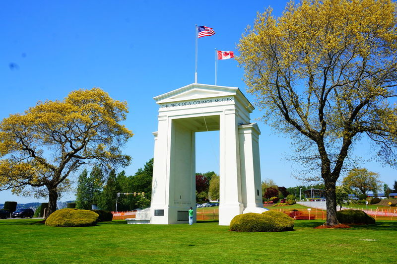 Peace Arch Architecture Autumn Branch Building Exterior Built Structure Day Flag Grass History Leaf Memorial Nature No People Outdoors Patriotism Peace Arch Canadian Border Pride Sky Tree