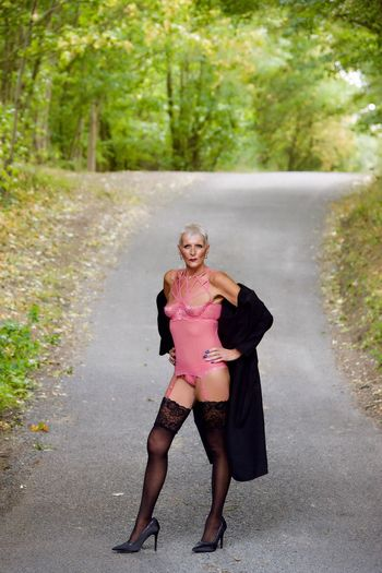 Road Location Pose Stockings Coat Lingerie Full Length One Person Front View Road Plant Day Real People Women Standing Pink Color Looking At Camera Portrait Tree Clothing Outdoors