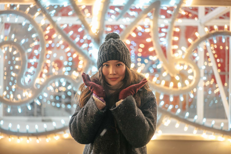 Christmas Christmas Decoration Portrait New Year Illuminated Warm Clothing Front View One Person Lighting Equipment Clothing Winter Looking At Camera Leisure Activity Young Adult Real People Young Women Lifestyles Night Women Standing Smiling Scarf Outdoors Beautiful Woman Light