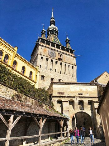 Medieval towns Sighisoara-Romania Eastern Europe Quaint Places Medieval Town Young Girls Walled City Historical Building Eye Em Around The World Street Photography Building Exterior Architecture Built Structure Building Sky Low Angle View Nature Day Travel Destinations The Past Place Of Worship History Group Of People Sunlight Outdoors Clear Sky