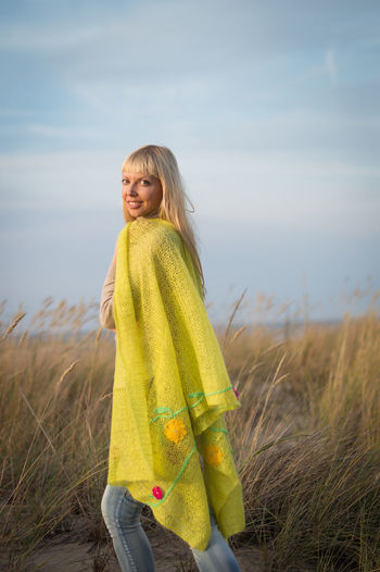 Millennial at beach in yellow knitted scarf and jeans Smiling One Person Blond Hair Land Sky Field Looking At Camera Women Leisure Activity Happiness Grass Lifestyles Plant Standing Real People Nature Portrait Casual Clothing Three Quarter Length Hair Hairstyle Beautiful Woman Outdoors International Women's Day 2019