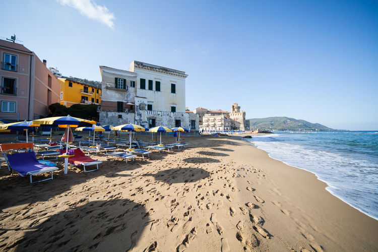 Scenic view of Castellabate Beach Buildings Campania Castellabate Holiday Italy Salerno Sea Summer Town Umbrellas Vacations