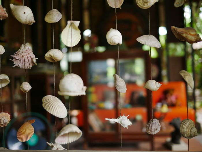 Close-up of decorations hanging for sale in store