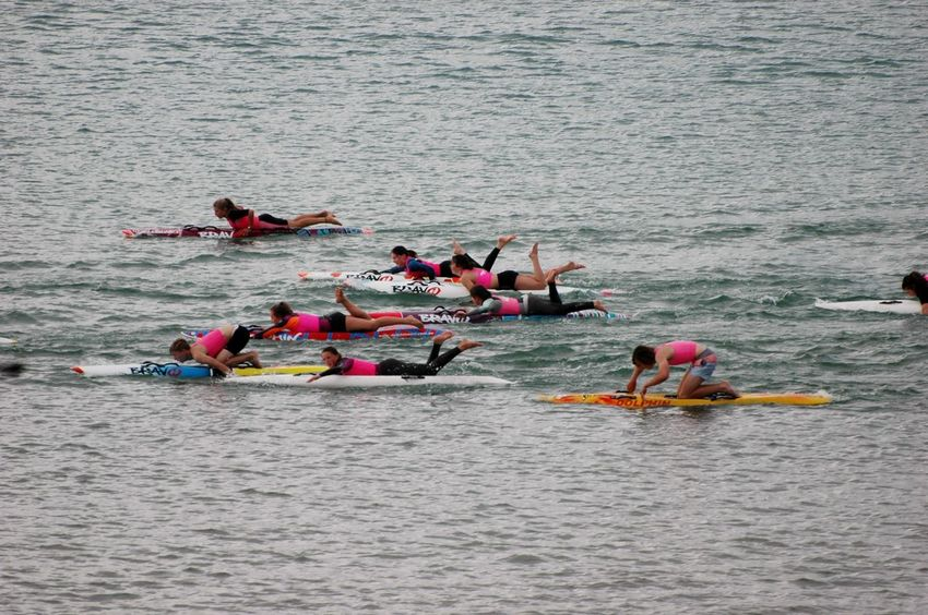 Waiting Game Large Group Of People Mode Of Transport Outdoors Leisure Activity Real People Sports Race Adventure Sport Competition Water Sports Team People Paddling Sea Activities Teenagers  Group Activity Surfing Boarding Lessons Training Day Competitions Wet Suits Teamwork Efforts