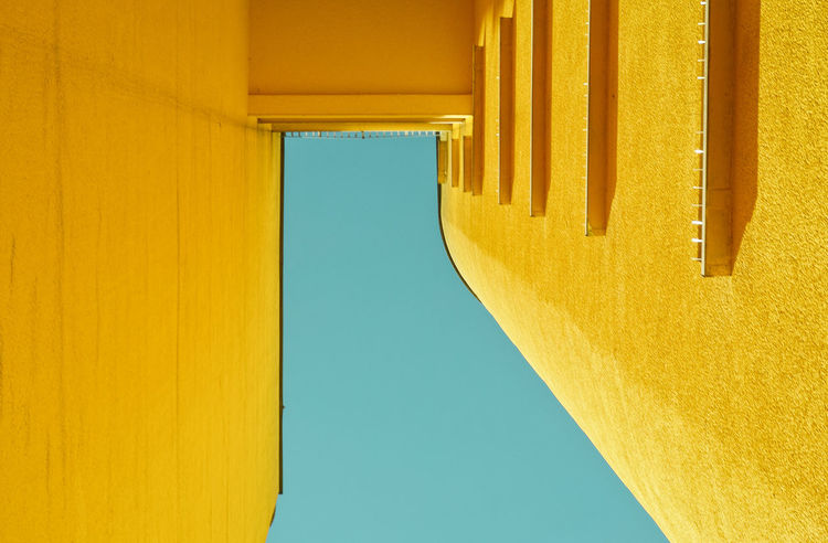 TheWorldNeedsMoreYellow Architectural Column Architecture Blue Building Building Exterior Built Structure Clear Sky Close-up Day Directly Below Low Angle View Nature No People Orange Color Outdoors Sky Sunlight Wall - Building Feature Window Wood - Material Yellow
