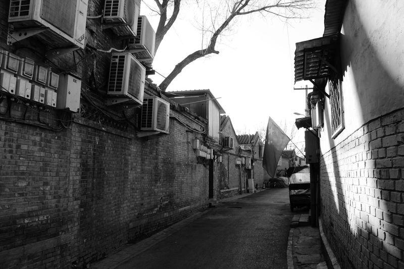 Architecture BEIJING北京CHINA中国BEAUTY Black And White Blackandwhite Building Exterior Built Structure City Hutong Hutong Life Light And Shadow Style Of China The Way Forward Flags In The Wind  Flag Chinese Flag Welcome To Black