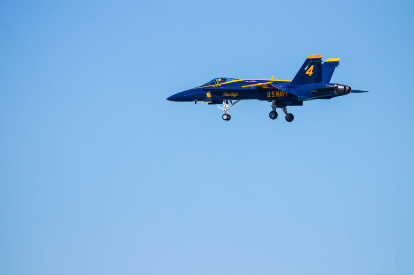 Navy Blue Angels Aerobatics Air Vehicle Airplane Blue Clear Sky Copy Space Day Fighter Plane Flying Low Angle View Mid-air Military Airplane Mode Of Transportation Motion Nature No People on the move Outdoors Plane Sky Transportation Travel