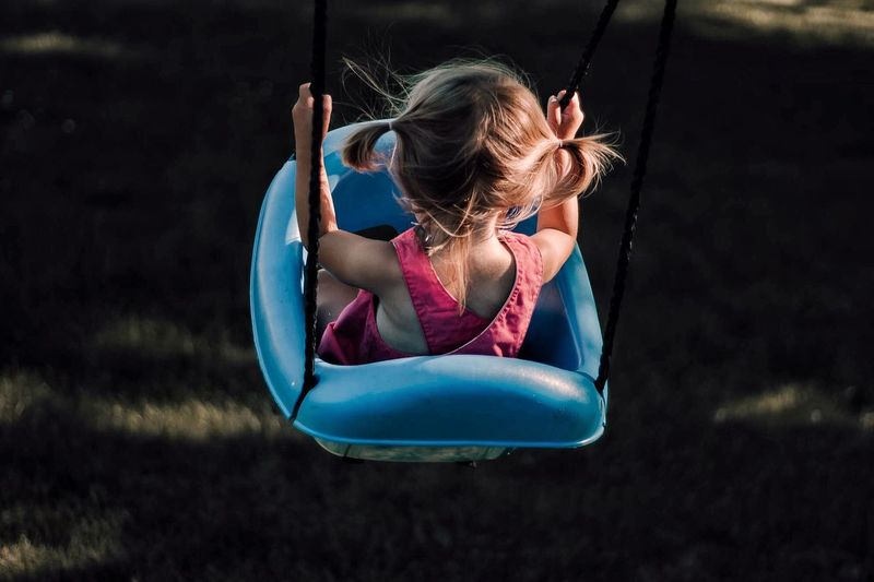 Girl in swing