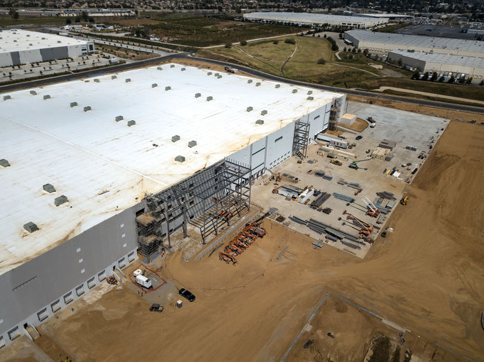 Beaumont, CA / USA - 4/20/2019: Overhead view of a new Amazon Fulfillment Center under construction. High Angle View Day Architecture Built Structure No People Outdoors Construction Construction Site Warehouse Distribution Logistics Equipment New Building  Amazon Overhead View Aerial View Industry Building Exterior Transportation Mode Of Transportation Road Construction Industry Travel Environment Land Business Nature Fuel And Power Generation