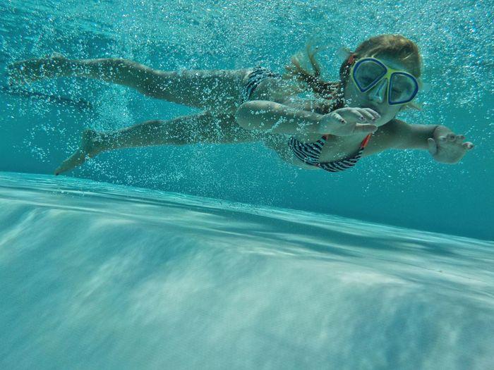 Portrait of girl swimming in pool