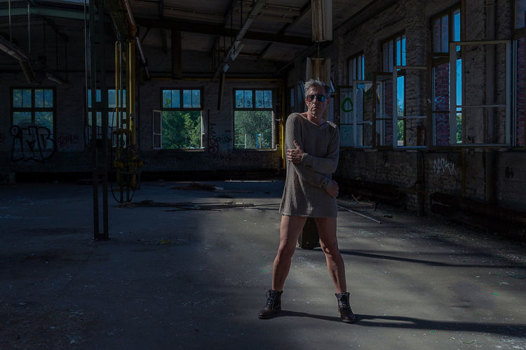 Portrait of man wearing dress while standing in abandoned house