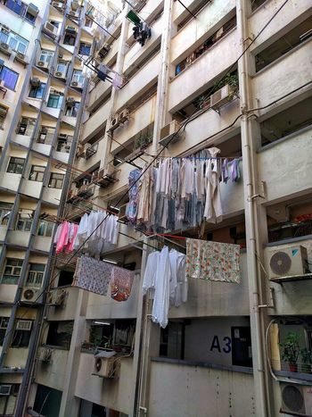 laundry on bamboo Check This Out Clothes Laundry City Life Urban Exploration Walking Around Travel Photography EyeEm Best Shots Mobilephotography Building Exterior Hong Kong Backgrounds Architecture Day Built Structure No People