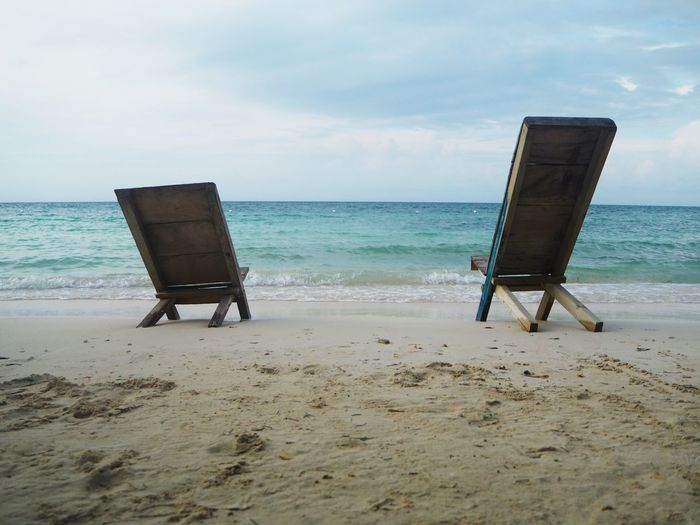 Absence Beach Beauty In Nature Chair Horizon Horizon Over Water Land No People Relaxation Sand Scenics - Nature Sea Seat Sky Tranquil Scene Tranquility Water