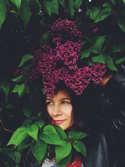 Portrait Of Woman In Flower Bush
