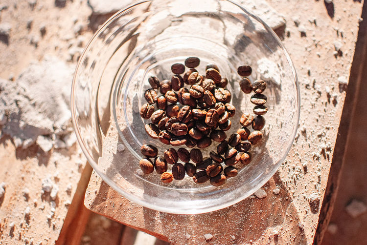 Food And Drink Food High Angle View Roasted Coffee Bean No People Freshness Brown Still Life Close-up Coffee - Drink Coffee Abundance Large Group Of Objects Table Focus On Foreground Glass - Material Container Nature Roasted Coffee Crop Caffeine