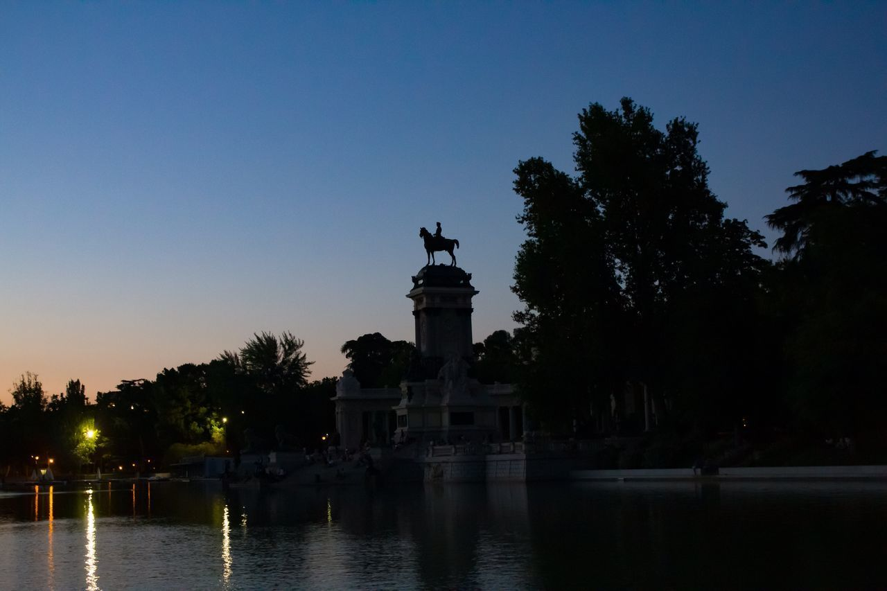 sky, tree, water, plant, architecture, sculpture, no people, statue, clear sky, nature, travel destinations, representation, human representation, illuminated, art and craft, built structure, dusk, travel, silhouette, outdoors