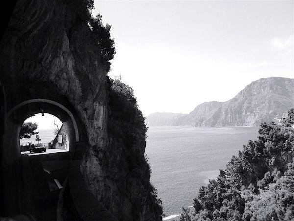 Bnw_friday_eyeemchallenge Roadscapes Amalfi Coast Italy Tunnel Sea Car Blackandwhite