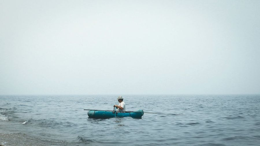 People sitting on boat in sea