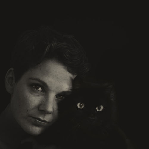 Portrait Of Woman With Cat In Darkroom