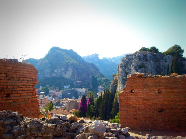 Taormina And Etna Architecture Stone Material Fortified Wall The Past Ruined Exterior Wall Built Structure Medieval Outdoors Sicily Stone Wall Teatro Antico Di Taormina Old Ruin No People Physical Geography Green Color Rock Formation Beauty In Nature Scenics Clear Sky Geology
