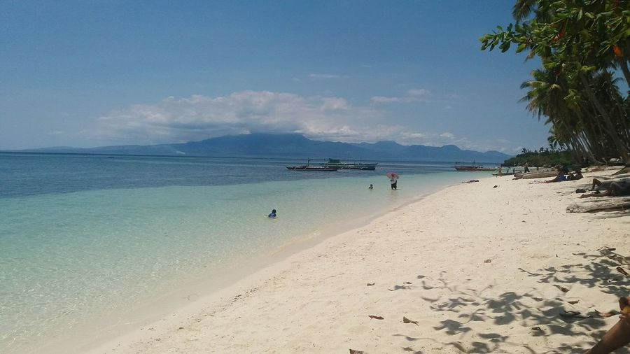 Paliton Beach Philippines Sea Beach White Sand Sand Nature Vacations Sky Blue Sky Outdoors Travel Destinations Horizon Over Water Scenics Coastline People Water Beauty In Nature Day Seasonal Photography Seasonal Summertime Island View  Adults Only
