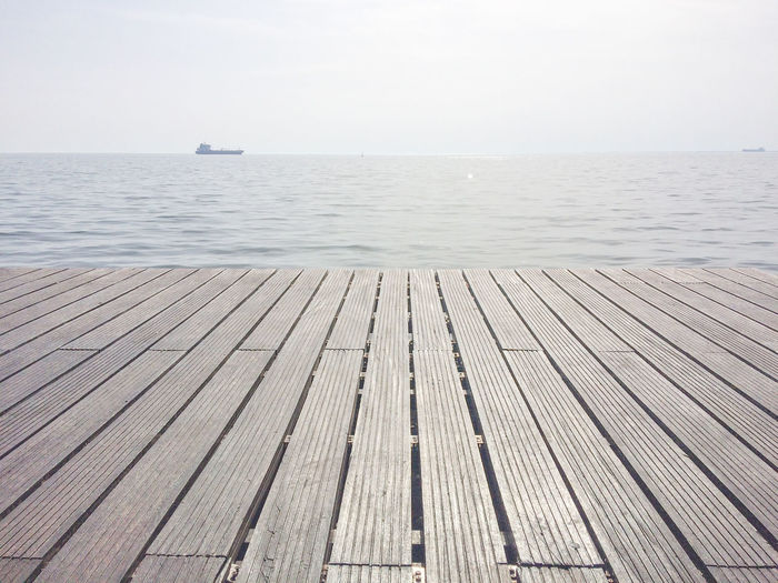 Wooden terrace and tropical seascape .Summer background. Wooden floor and sea on background Water Sea Sky Horizon Horizon Over Water Beauty In Nature Wood - Material Scenics - Nature Tranquility Tranquil Scene Day No People Nature Pier Clear Sky Direction Idyllic Wood Paneling Nautical Vessel Outdoors Wood