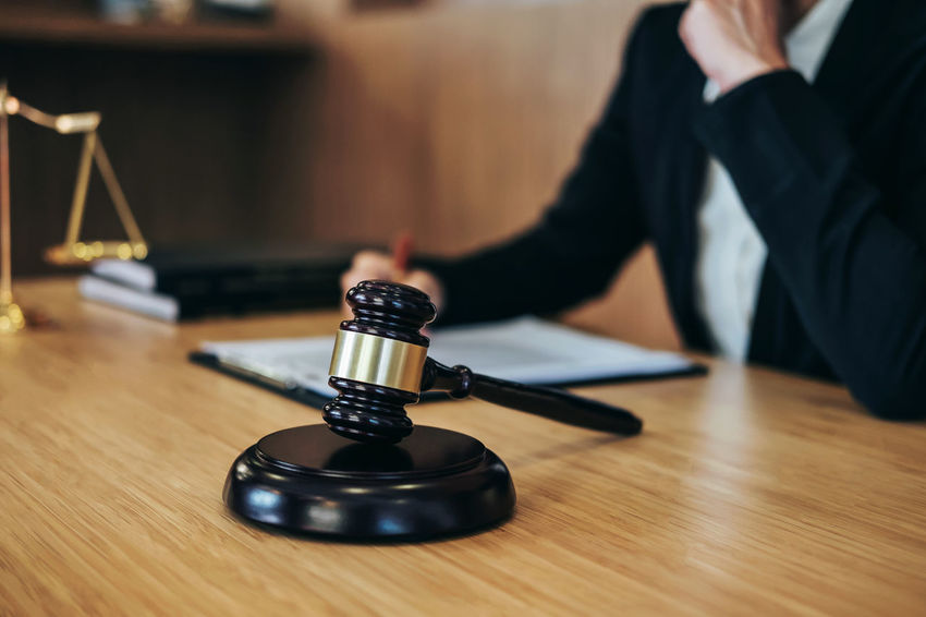 Lawyer Adult Arts Culture And Entertainment Balance Barrister Close-up Counselor Fairness Gavel Hand Human Body Part Human Hand Indoors  Inheritance Judgement Justice Legal Legislation Men One Person Selective Focus Sitting Technology Verdict Wood - Material