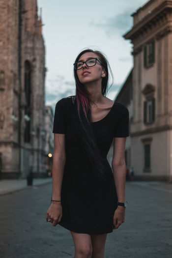 Portrait Of A Woman Architecture Beautiful Woman Building Exterior Built Structure Day Eyeglasses  Front View Girlfriend Leisure Activity Lifestyles Long Hair One Person Real People Standing Three Quarter Length Young Adult Young Women