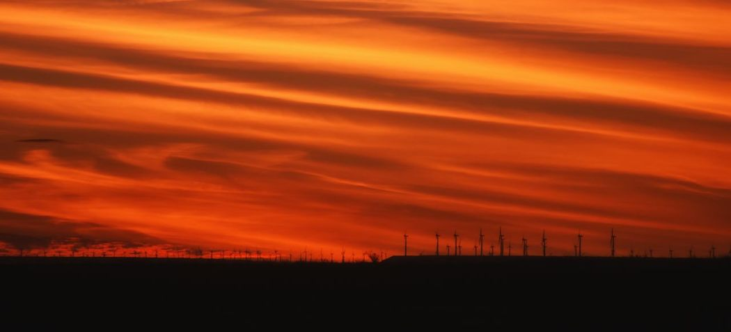 Orange Color Sunset Scenics Dramatic Sky No People Sky Beauty In Nature Nature Cloud - Sky Outdoors Landscape Alternative Energy Power In Nature Sunsetsaroundtheworld Rural Scene Dramatic Sky Farmlandscape West Texas EyeEm Masterclass This Week On Eyeem Nikonphotographer Texas Photographer Eyeemphotography Sunlight Sunset Silhouettes