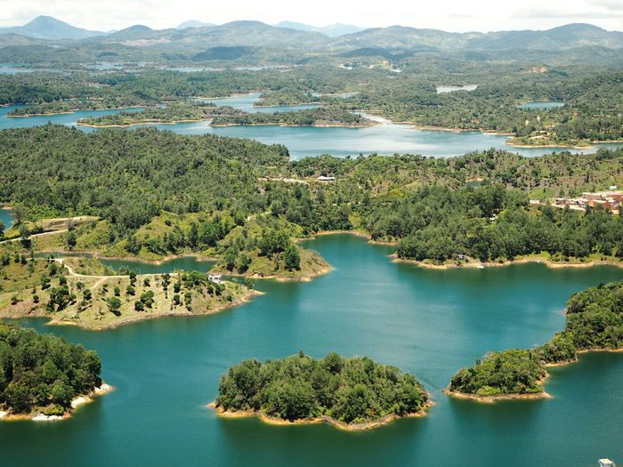 Guatape Forest EyeEm Selects Water Mountain Tree Lake High Angle View Sky Landscape Rocky Mountains Remote Idyllic Scenics Wilderness Tranquility