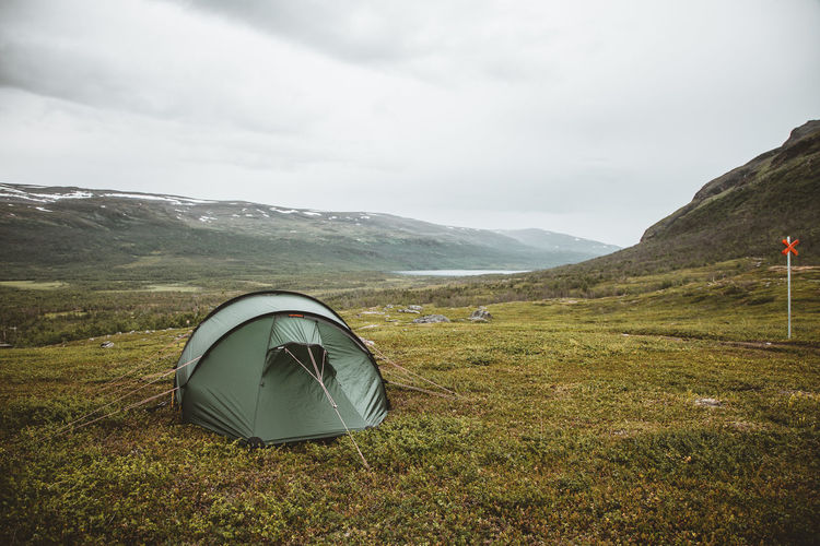 Hiking in Swedish Lappland An Eye For Travel Beauty In Nature Camping Day Field Grass Landscape Mountain Mountain Range Nature No People Outdoors Scenics Sky Tent Tranquil Scene Tranquility