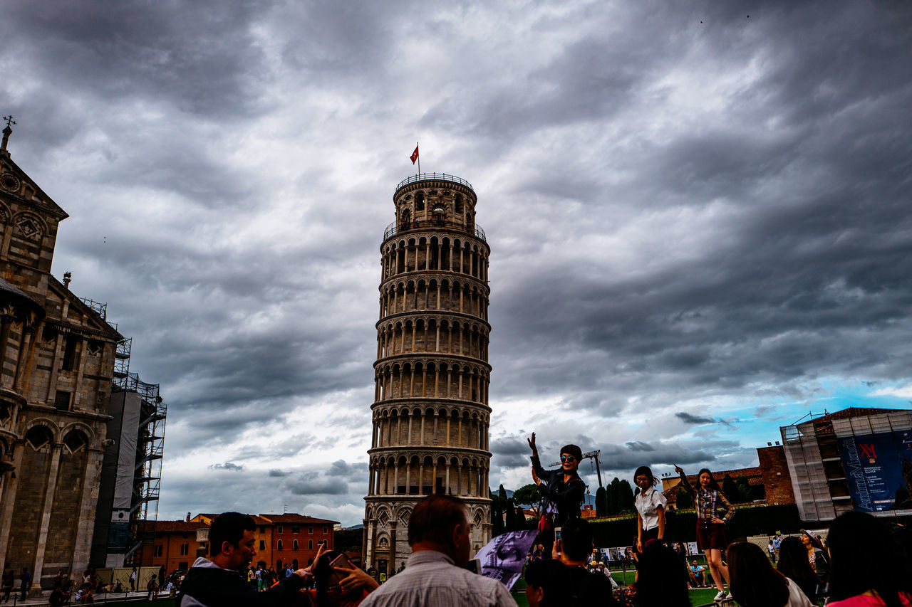 People By Leaning Tower Of Pisa Against Cloudy Sky
