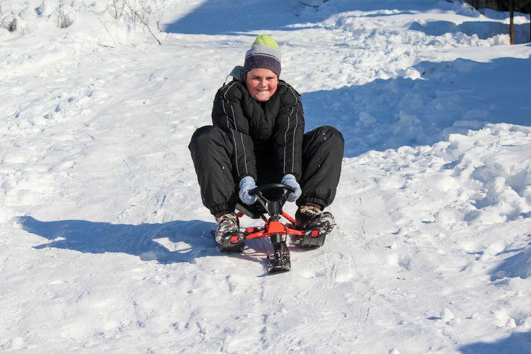 Full length of girl in snow