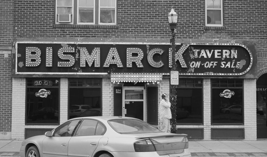 Fargo, ND / Downtown / February 25, 2016 Bismarck Tavern Building Exterior Capital Letter Communication Downtown Fargo Guidance Information Monochrome Non-western Script North Dakota Outdoors Pavement Red Sidewalk Sign Store Street Symbol Text Wall Western Script