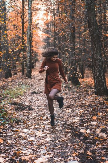 Orange Dress Fall Happy Happiness Orange Clothes Dancing Jumping Curly Hair Jump Tree Autumn Forest One Person Land Nature Leisure Activity Full Length Lifestyles Beauty In Nature Change Women Day Real People Adult Outdoors