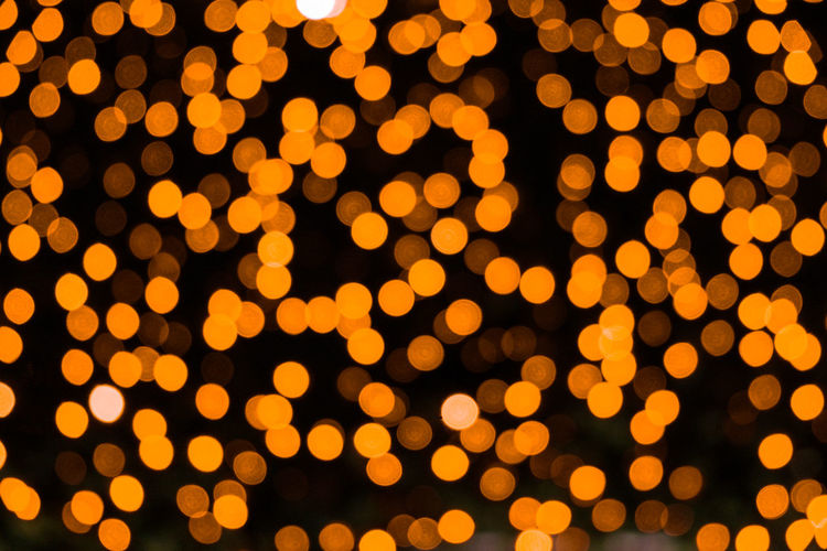 Colorful christmas abstract bokeh background. illumination light backdrop. festive street night
