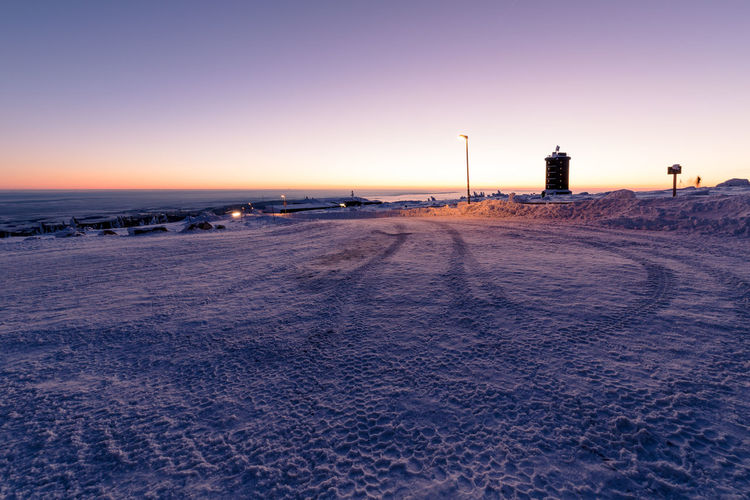 Sunset Sky Nature Sea Snow Water Winter Building Exterior Scenics - Nature Cold Temperature Land Built Structure Beauty In Nature Architecture No People Beach Tranquil Scene Orange Color Outdoors Winter Harz Harzmountains Brocken Sunrise