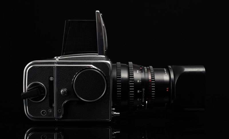 Hasselblad camera model 500cm with mounted Carl zeiss Sonnar 150mm f4 lens Analogue Photography Camera Hasselblad 500C/M Black Background Black Color Camera - Photographic Equipment Hasselblad Mediumformat Mediumformatphotography Photographic Equipment Photography Photography Themes Studio Shot Technology