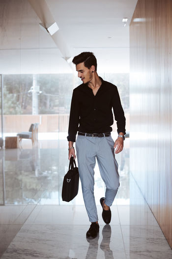 Full length of young man walking in corridor