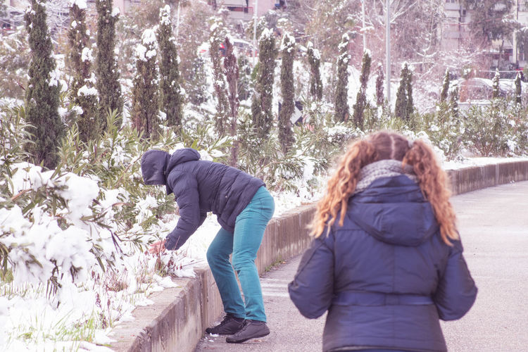 Rear view of women in winter