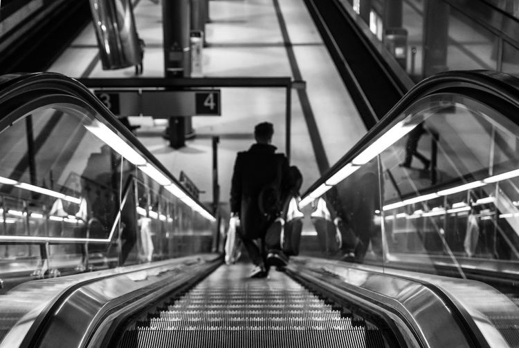 High Angle View Man On Escalator
