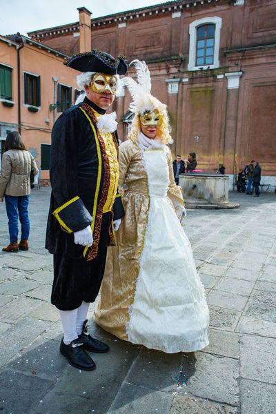 Carnival Carnivale In Venice Adult Adults Only Architecture Bonding Bride Bridegroom Building Exterior Built Structure Carnival Costumes Celebration Couple - Relationship Day Full Length Heterosexual Couple Husband Love Men Outdoors Real People Togetherness Walking Well-dressed Women Young Women