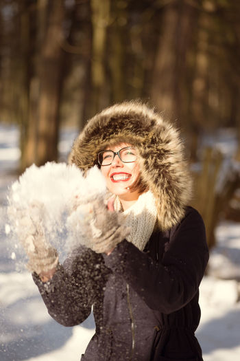 Adult Beautiful Woman Cheerful Cold Temperature Day Fur Fur Coat Happiness Leisure Activity Lifestyles Nature One Person Outdoors People Portrait Real People Smiling Snow Warm Clothing Winter Young Adult Young Women