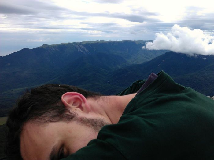 Close-up of man against mountain range