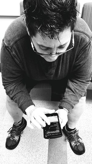 I like my baby having something to do while waiting for me at docs office! Things I LikeWaiting Smartphone Downward No Face Real People From Above  Glasses Spikey Hair Biding Time Black And White B&w Hospital Monochrome Photography Dramatic Angles Mobile Conversations Welcome To Black
