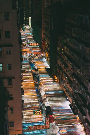High Angle View Of Illuminated Street Market Amidst Buildings